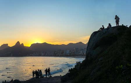 promontory: Rio De Janeiro, Brazil  - September 9, 2013: People on  the Pedra do Arpoador promontory at sunset Editorial