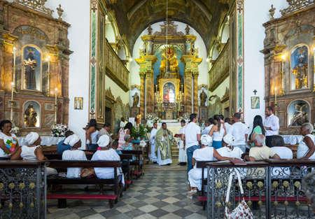 faithful: Salvador, Brazil - September 15, 2013: Pelourinho district, faithful during a religious ceremony in  the Nossa Sra. De Rosario Dos Pretos church Editorial