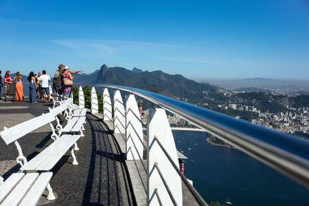 pao: Rio De Janeiro, Brazil - September 9, 2013: Tourist looking at the Botafogo bay from the Pao De Acucar Sugarloaf Mountain