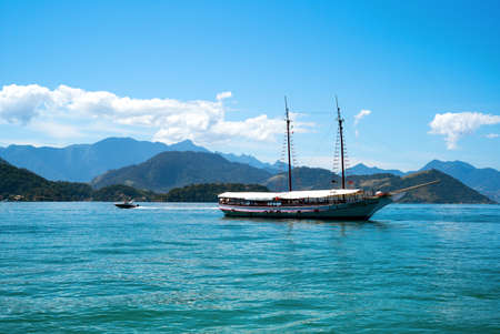 pity: Angra Dos Reis, Brazil - September 8, 2013: A tourist boat near Ponta de Let pity