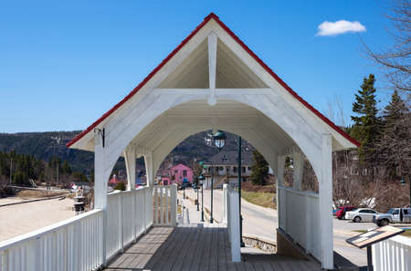Tedoussac,  Canada - May 8, 2014: Quebec, the  covered bridge that leads to the St Lorenzo river harbour