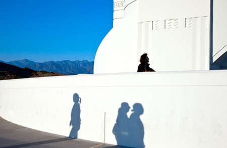 griffith: U.S.A., California, Los Angeles, shadows on the wall of the Griffith Observatory at the sunset Stock Photo
