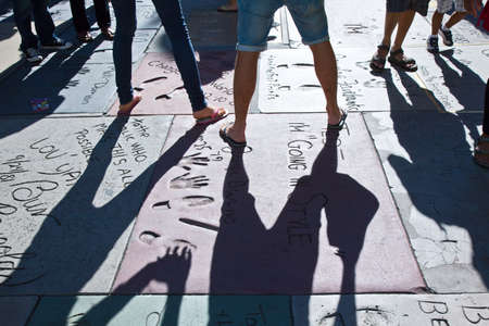 the celebrities: Los Angeles,  U.S.A. -  May 30, 2011:  Hollywood, hand and foot prints of celebrities outside the Graumans Chinese Theatre Editorial