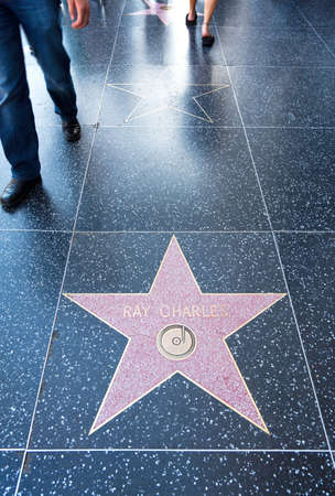 fame: Los Angeles,  U.S.A. -  May 30, 2011:  Hollywood, people in the Walk of Fame