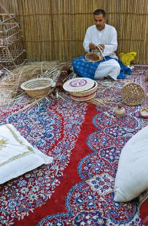 al: Al Jasra,  Bahrain - December 11, 2006:  Artisans at work in the Traditional Craft Center.