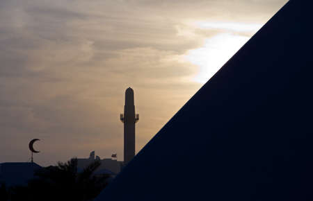 minaret: Bahrain, Manama, sunset view of a minaret of the city Stock Photo