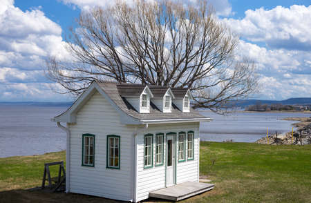 quebec: Roberval, Canada - May 10, 2014: Quebec,  a small typical houses on the St Jean lake. Editorial