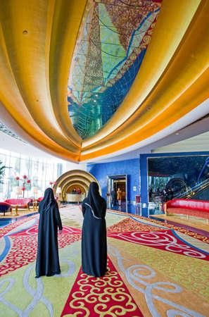 luxuries: Dubai, U.A.E. - February 19,  2007:  The colored reception hall of the luxury Burj Al Arab hotel
