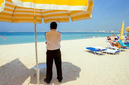 overseer: Dubai, U.A.E. - November 15, 2006:  An overseer on the  beach of the Oasis resort in the new Marina quarter