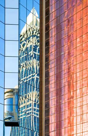 sheik: Dubai, U.A.E. - November 15, 2006: Reflrctions on the  architectures of the business area of the  Sheik Zaied Road.