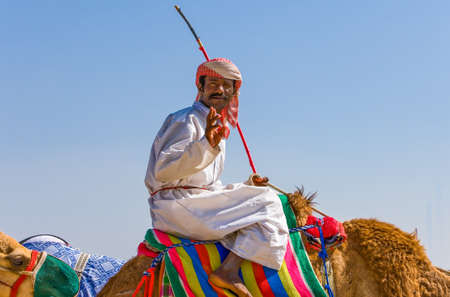 outskirts: Dubai, U.A.E. - February 18,  2007: A camel racing trainer in the outskirts of the city Editorial