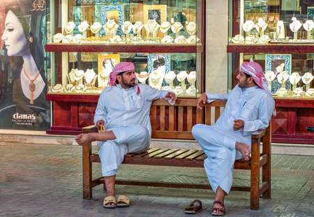 gold souk: Dubai, U.A.E. - February 17,  2007:  People in traditional dress in the famous Gold Souk