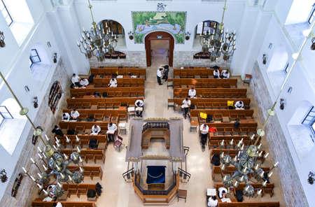 hurva: Jerusalem,  Israel - November 2, 2010:  Faithfull in the Hurva synagogue Editorial