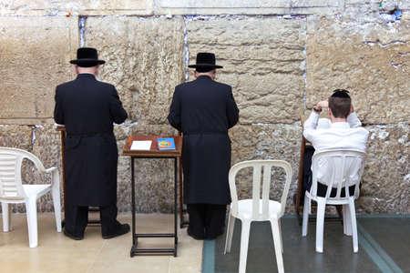 western wall: Jerusalem,  Israel - November 2, 2010:  Jewish faithfuls in prayer  at the western wall