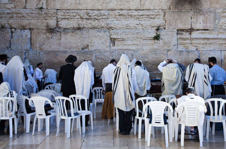 western wall: Jerusalem,  Israel - November 3, 2010:  Jewish faithfuls in prayer  at the western wall