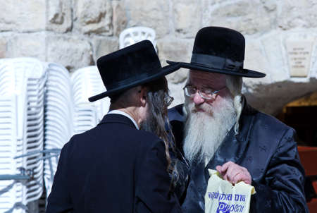 western wall: Jerusalem,  Israel - November 3, 2010:   Old Orthodox jews near the Western Wall