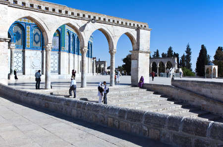 temple mount: Jerusalem,  Israel - November 3, 2010:  Local people under a gateway to the Temple Mount (Har Habait) Editorial