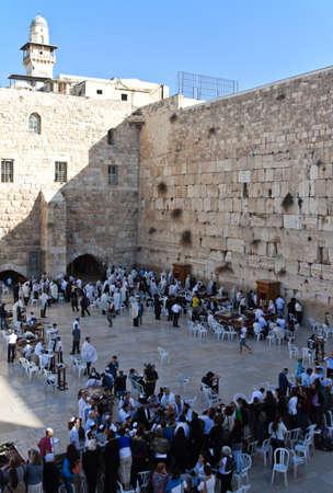 western wall: Jerusalem,  Israel - November 4, 2010:  Jewish faithfuls in prayer at the western wall