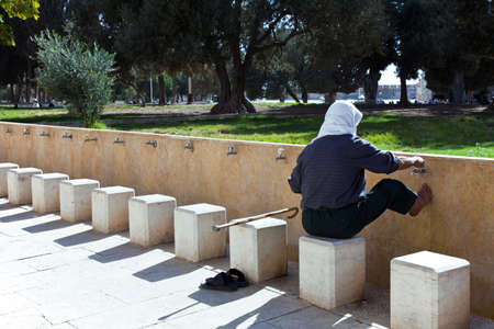 israel people: Jerusalem,  Israel - November 4, 2010:  Local people washing on the Temple Mount (Har Habait)