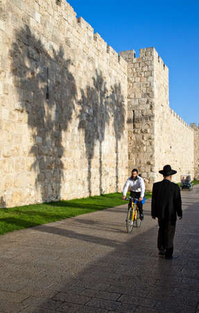 israel people: Jerusalem,  Israel - November 4, 2010: People near the wall near the Jaffa gate Editorial