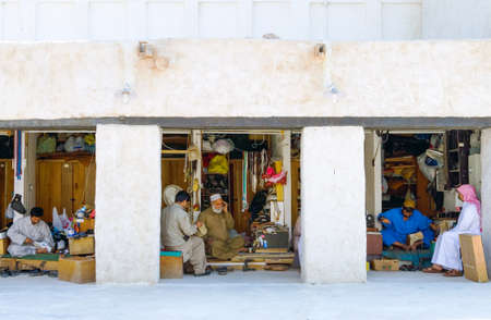 souq: Doha,  Qatar - February 25, 2006: Local people and handicraft in the Souq Wakif in the old city center Editorial