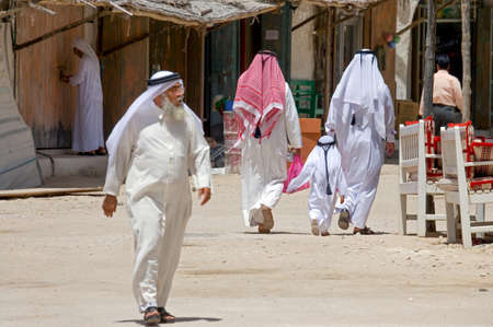 old people: Doha,  Qatar - April 8, 2006: Local people in the Souq Wakif in the old city center