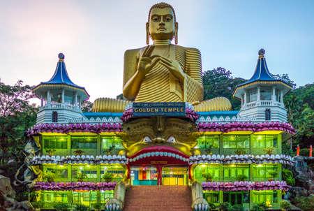 sri lanka temple: Danbulla, Sri Lanka - December 5, 2012: The large Buddah statue at the entrance of the Golden Temple