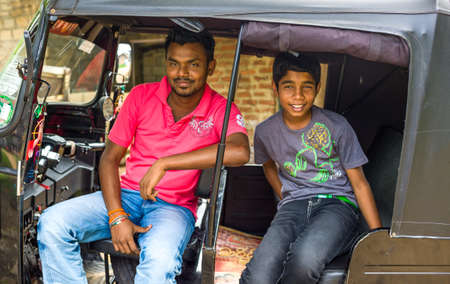 three wheeler: Sigirija, Sri Lanka - December 8, 2012: Local people smiling in a typical three wheeler taxi