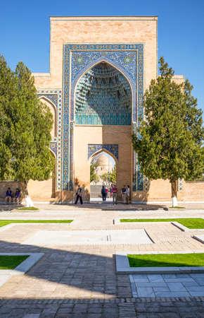 registan: Samarkand, Uzbekistan - April 18, 2014: People near the portal leading to the Registan square