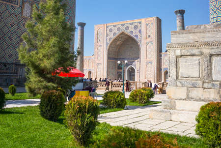 registan: Samarkand, Uzbekistan - April 18, 2014:  The garden leading to the Registan square with the wanderful mosque and madrassah