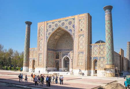 registan: Samarkand, Uzbekistan - April 18, 2014: People in  Registan square with the Ulugbek madrassah