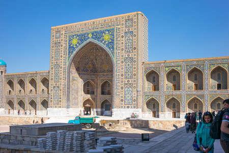registan: Samarkand, Uzbekistan - April 18, 2014: People in  Registan square with the Tilla Kari madrassah in the background