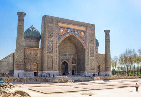 registan: Samarkand, Uzbekistan - April 18, 2014: People around the Sher Dor madrassah in Registan square