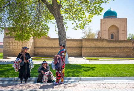 registan: Samarkand, Uzbekistan - April 18, 2014:  Local craft vendors near Registan square