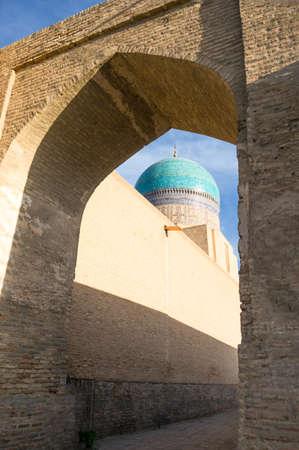 uzbekistan: Uzbekistan, Bukhara, side view of the Mir-i-Arab madrassah blue dome