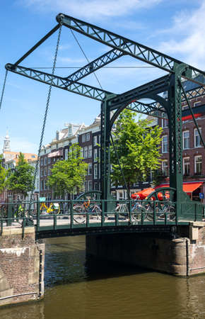 red light district: Amsterdam, Holland - July 22, 2014: Red Light district. a traditional drawbridge