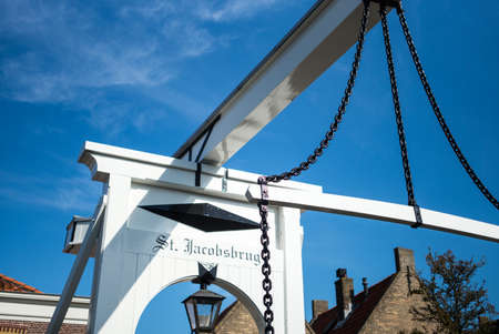 drawbridge: Monnickemdam, Holland - July 24, 2014: Waterland district,  a small drawbridge in the old town Editorial