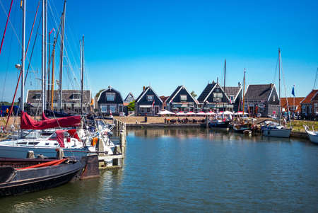 marken: Marken, Holland - July 24, 2014: Waterland district, people and boats in  the little harbour