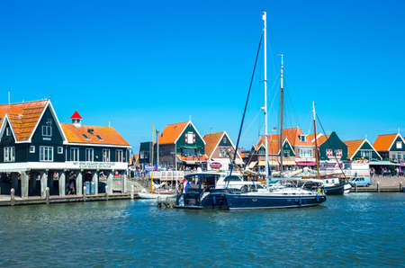 volendam: Volendam, Holland - July 24, 2014: Waterland district, the harbour in front of the town center Editorial