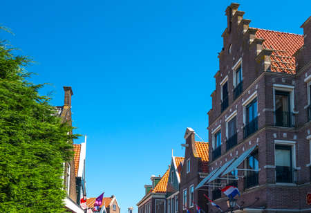 volendam: Volendam, Holland - July 24, 2014: Waterland district, typical houses of the town center Editorial