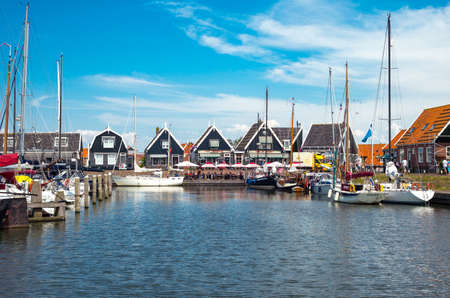 marken: Marken, Holland - July 24, 2014: Waterland district, boats in the little harbour of the village