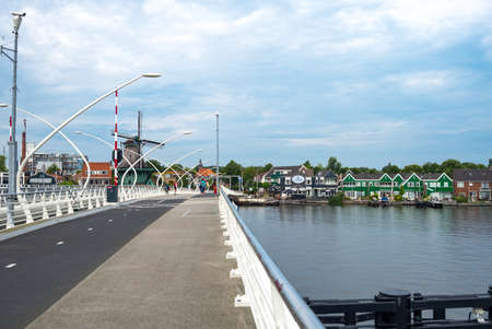 zaandam: Zaandam, Holland - July 25, 2014: Waterland district, a modern bridge in the famous area of the mills
