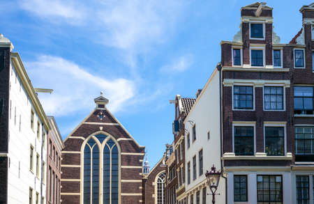red light district: Amsterdam,  traditional buildings and a church in Red Light district. Editorial