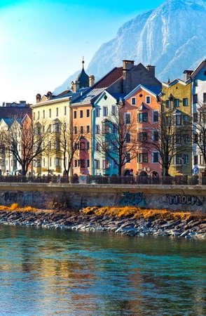 inn: Innsbruck, Austria - February 8, 2010:  The Mariahilf strasse colored houses on the Inn river