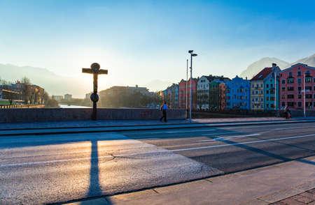 Innsbruck, Austria - February 8, 2010:  People walking on the Innbruck bridge at sunset