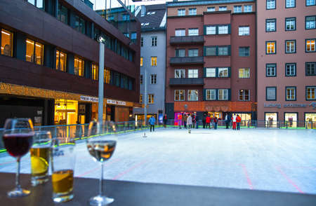 innsbruck: Innsbruck, Austria - February 8, 2010:  Wine, beer and ice rinnk in the old city center Editorial