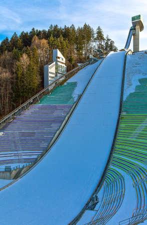 innsbruck: Innsbruck, Austria - February 8, 2010: The snowy Bergisel skijamping stadium at sunset Editorial