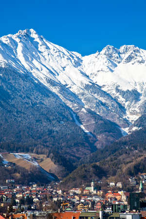 innsbruck: Austria, Tyrol, panoramic wiew over Innsbruck and Inn valley with the snowy mountains in the background Stock Photo