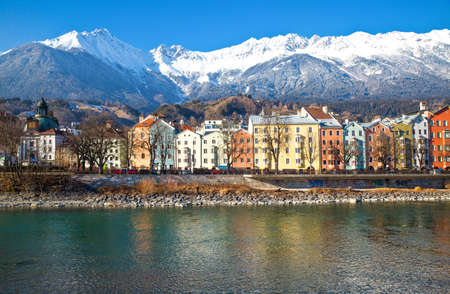 innsbruck: Austria, Tyrol, Innsbruck, the Mariahilf strasse colored houses on the Inn river with the snowy mountains in the background