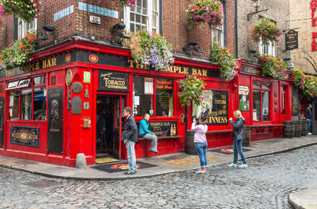 Dublin,  Ireland - July 31, 2013: Young people in fron of a pub in  Temple Bar quarter